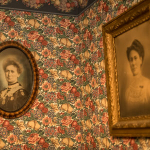 19th century portraits and elaborate wallpaper