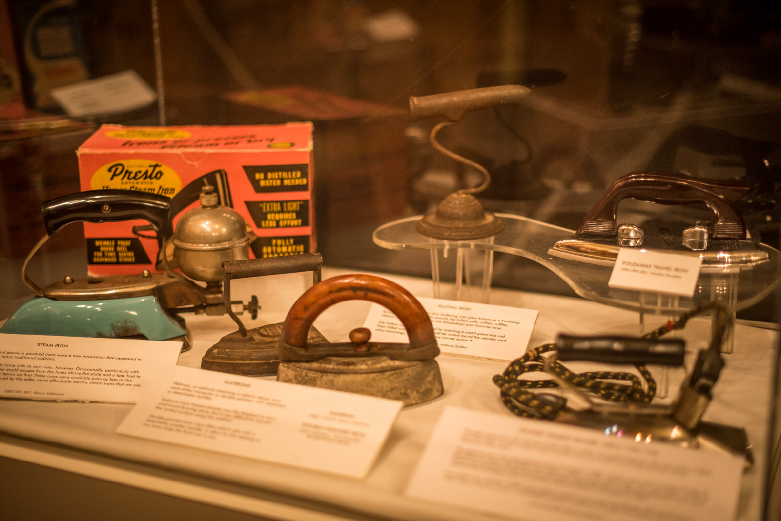 Display in the museum's main room showcasing a variety of iron degns from the early 1900s to the 1940s