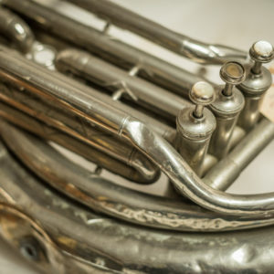 Close up of a French horn housed in the museum's collection storage