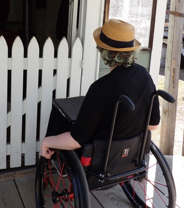 Woman in wheelchair demonstrating the eye-level barrier