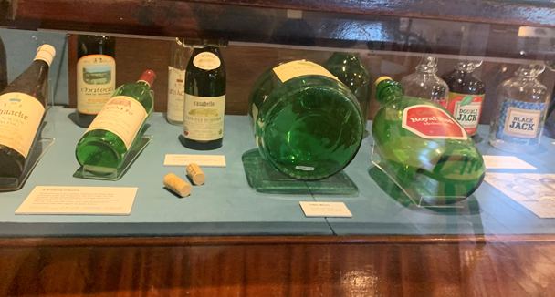 Exhibit of bottles that is difficult to see due to the angle of the lables.