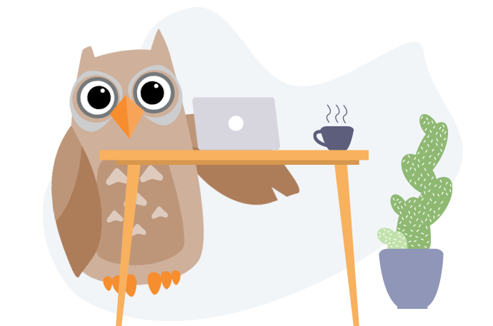 Owl at a desk with a laptop and cup of coffee